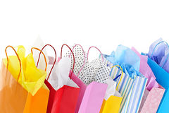 Shopping bags. Many colorful shopping bags on white background stock photography