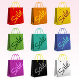 Shopping Bags. Illustration of nine colorful shopping bags with Sale text on them Royalty Free Stock Images
