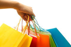 Shopping bags. A woman hand carrying a bunch of colorful shopping bags stock photography