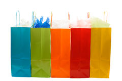 Shopping bags. An isolated shot of bunch of colorful shopping bags stock images