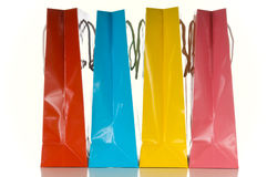 Shopping Bags. Multicolored shopping bags on white background royalty free stock photos