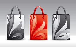 Shopping bags. Three vector shopping bags in different color schemes Stock Image