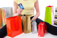 Shopping bags around a woman holding a credit card Stock Image