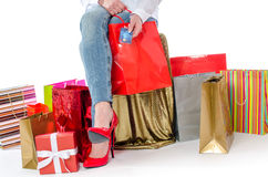 Shopping bags around a woman holding a credit card Stock Photos