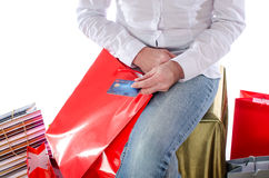 Shopping bags around a woman holding a credit card Royalty Free Stock Image