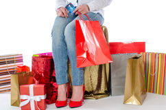 Shopping bags around a woman holding a credit card Royalty Free Stock Photos