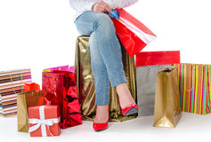 Shopping bags around a woman holding a credit card Stock Photography
