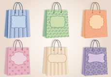 Shopping bags with blank labels, vector Royalty Free Stock Photography