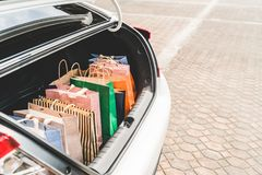 Shopping bags in car trunk or hatchback, with copy space. Modern shopping lifestyle, rich people or leisure activity concept Royalty Free Stock Image