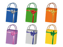 Shopping bags collection. A collection of vector shopping bags of different colors decorated with ribbons and bows Royalty Free Stock Photo