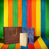 Shopping bags on colorful wood. Background Royalty Free Stock Image