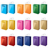 Shopping-bags-in-different-colours. Colourful bags with two types of handles, on a white background Stock Images