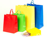 Shopping bags with euro cash Royalty Free Stock Photo