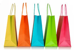 Shopping bags. Five colorful shopping bags closeup isolated on white Royalty Free Stock Image