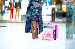 Shopping bags in front of woman legs Royalty Free Stock Photography