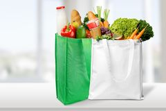 Shopping bags with grocery products on light. Shopping shop grocery products bags view close royalty free stock images