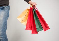 Shopping bags in hand Royalty Free Stock Photo