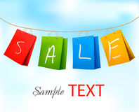 Shopping bags hanging on a rope with SALE on them. Stock Images