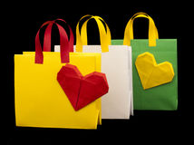 Shopping bags with heart. Isolated origami Stock Image