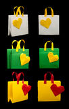 Shopping bags with heart. Isolated origami Stock Photo