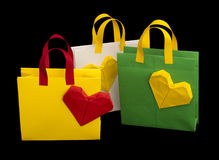 Shopping bags with heart. Isolated origami Stock Photography