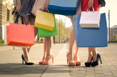 Shopping bags. Image shopping bags and feet with heels Royalty Free Stock Images