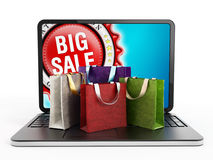 Shopping bags on laptop computer keyboard Stock Image
