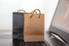 Shopping bags on a laptop keyboard. Online shopping, e-commerce concept.  royalty free stock image