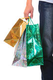 Shopping Bags. In a Male Hand Closeup Isolated On The White Background Royalty Free Stock Photo
