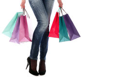 Shopping bags near legs in jeans and high heels Royalty Free Stock Photos