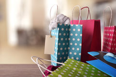 Shopping bags with new clothes inside in a shop front stock images