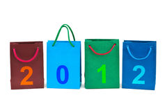 Shopping bags and numbers 2012. On white background Royalty Free Stock Photos
