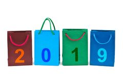 Shopping bags and numbers 2019. Isolated on white background stock photo