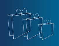 Shopping bag illustration. Shopping bags illustrated in brown outline on blue Royalty Free Stock Photos