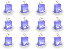Shopping bags printed with discounts Royalty Free Stock Photo