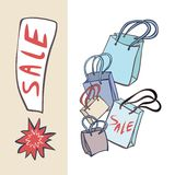 Shopping Bags and the Sale Banner. Royalty Free Stock Image