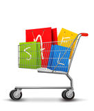 Shopping bags with sale in shopping cart. Concept  Royalty Free Stock Photography