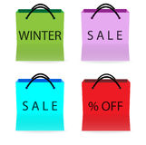 Shopping bags with sale signs Stock Images