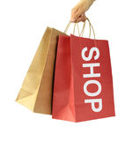 Shopping bags with SHOP text and isolated on white background. Royalty Free Stock Photography