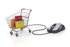 Shopping bags in the shopping cart with computer mouse. Stock Photos
