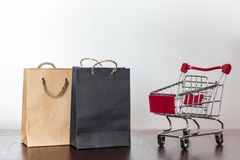 Shopping bags and shopping cart.  stock images