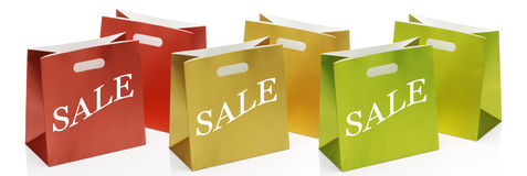 Sale Shopping Bags. Six coloured sale shopping bags in a row stock photos