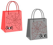 Shopping bags with a spider and web. On white background Royalty Free Stock Image