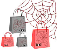 Shopping bags with a spider and web. On white background Royalty Free Stock Photo