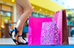 Shopping bags on the stairs next to woman feet Royalty Free Stock Images