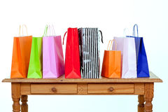 Colorful shopping bags on table Stock Image