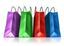 Shopping bags symbol. Shopping bags in a multi color group representing consumer shoppers retail spending habits from malls and shops Royalty Free Stock Photos