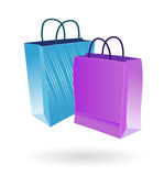 Shopping bags two colors. Illustration of two paper shopping bags on white background Stock Images