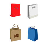 Shopping bags vector illustration. Set of Colorful Empty Shopping Bags Isolated vector set. Shopping bags fashion design store merchandise handle package Royalty Free Stock Images