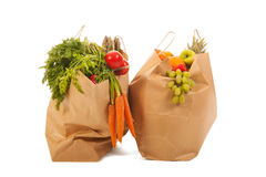 Shopping bags vegetables and fruit. Heavy shopping bags full with vegetables and fruit Stock Image